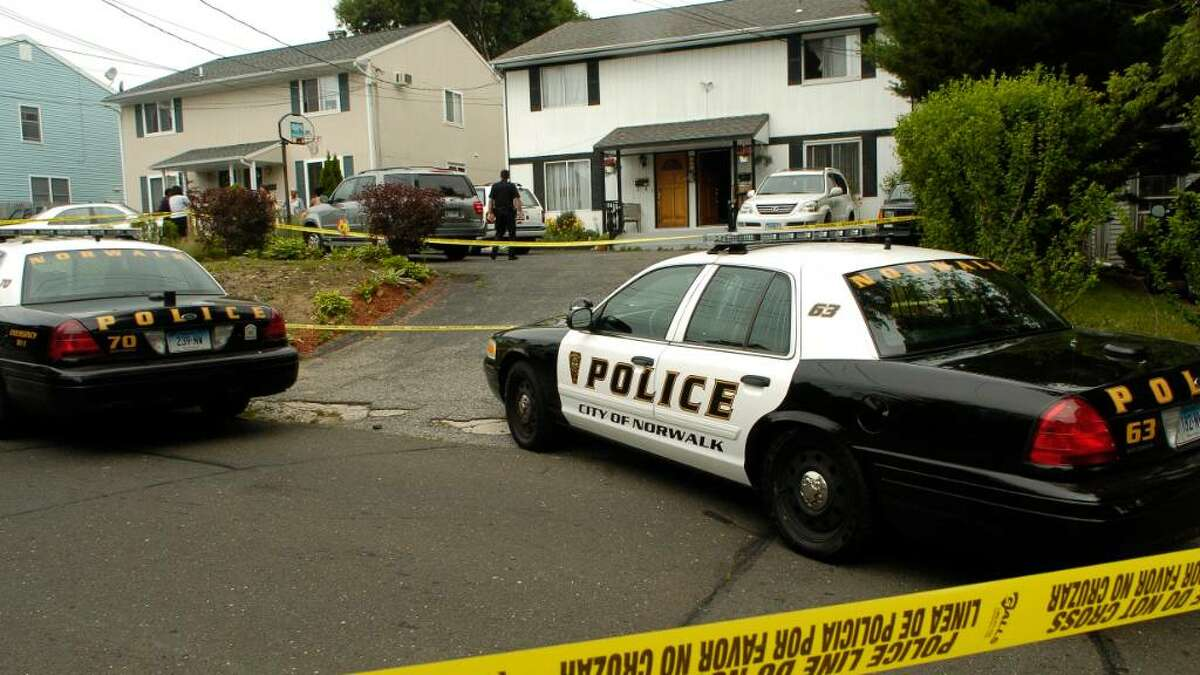 Enid Dickens, 57, and her 73-year-old mother were shot to death this morning June 14, 2010 at their home on 31 Couch Street in Norwalk, Conn. Dicken's ex-husband Gilbert Orlando, 56, was taken into custody in connection with the deaths.