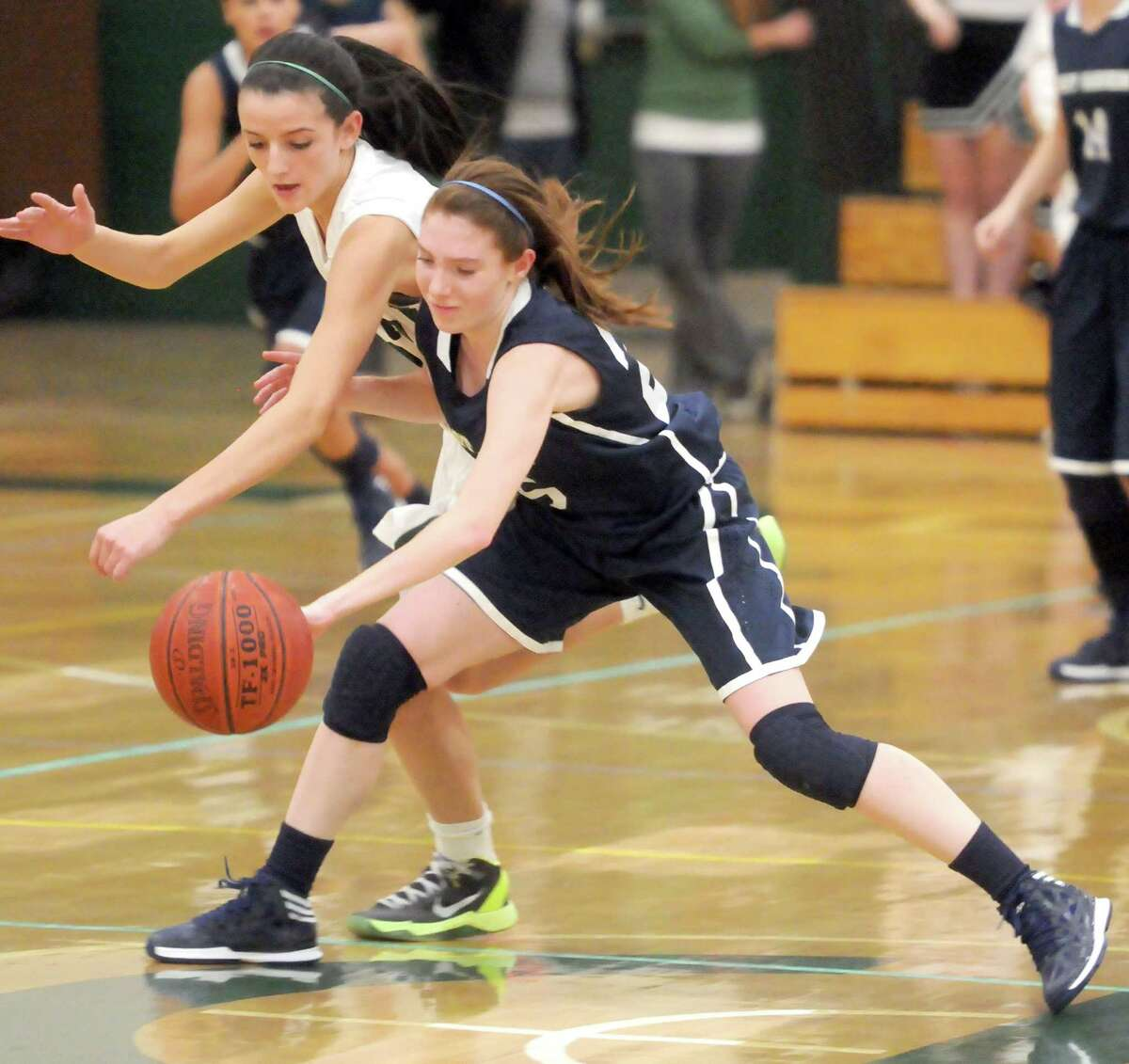(Mara Lavitt ?' New Haven Register) December 20, 2013 Guilford East Haven at Guilford girls basketball: Guilford's Meredith Shank, left, and East Haven's Jessica Benevento.