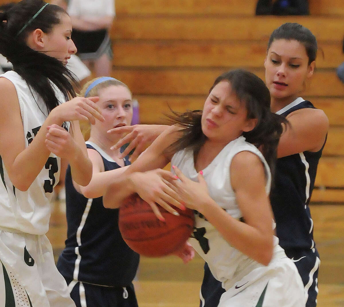 (Mara Lavitt ?' New Haven Register) December 20, 2013 Guilford East Haven at Guilford girls basketball: from left: Guilford's Meredith Shank, East Haven's Tori Carlson, Guilford's Amy Puchini and East Haven's Jillian Korwek.