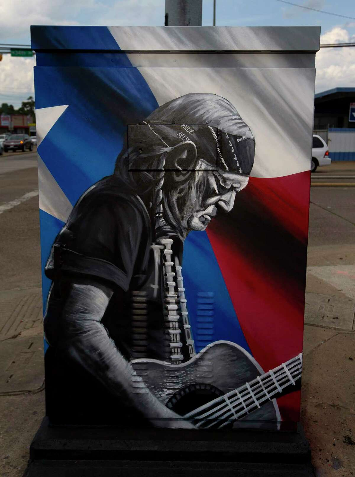 Street artist w3r3on3 painted this mural of Willie Nelson on a traffic signal control box near 34th and Ella.