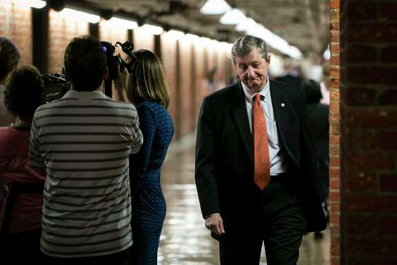 Sen. John Kennedy heads to the Capitol in Washington where lawmakers scrambled to defuse the president's threat to cut off critical health insurance payments.