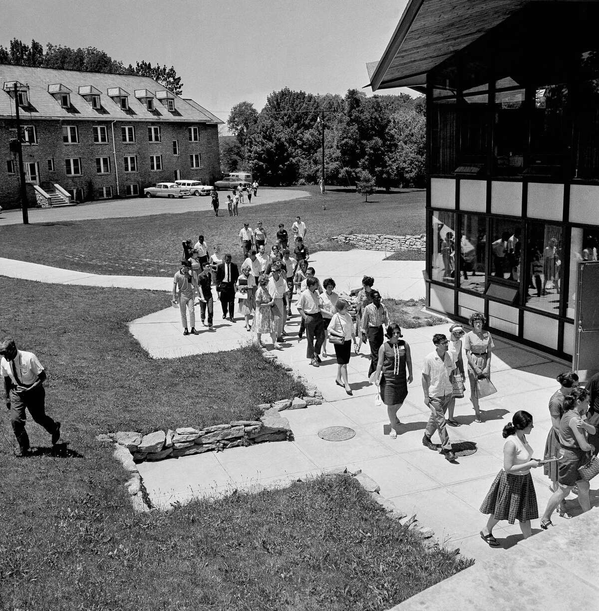 ADVANCE FOR USE SUNDAY, JUNE 15, 2014, AND THEREAFTER - FILE - In this June 24, 1964 file photo, black and white students attending an indoctrination course before going to Mississippi to aid in black voter registration and education for summer, walk across the campus of Western College for Women where the classes are being held in Oxford, Ohio.