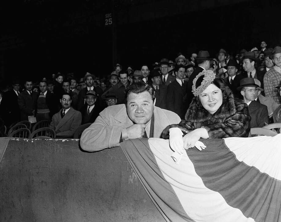 Babe Ruth, long known as the home run king, was just an interested spectator, April 20, 1939 in New York as he and his wife Claire turned out for the American League opener between the New York Yankees and the Boston Red Sox.  Yanks won, 2-0, it being the first time since the mighty Babe was the big gun of their artillery that the Yanks won their opener. (AP Photo/John Lindsay) Photo: John Lindsay, ASSOCIATED PRESS / AP1939