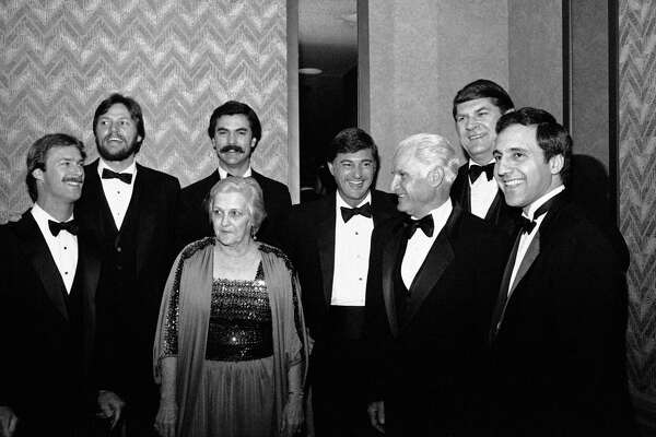 Members of the all-time Boston Red Sox dream team as voted by New England fans gather around Dorothy Pirone, left, foreground, the daughter of Babe Ruth, at the Boston Baseball Writers' Association dinner, Jan. 27, 1983. The team members from left are: shortstop Rick Burleson, catcher Carlton Fisk, outfielder Dwight Evans, outfielder Carl Yastrzemski, second baseman Bobby Doerr, pitcher Dick Radatz, and third baseman Rico Petrocelli. Babe Ruth was selected to the team as a left handed pitcher.