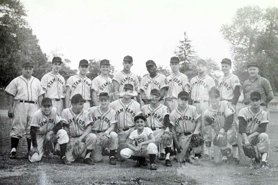 """The 1957 caption that was ran with this photo in the Advocate: The State Champion Oscar H. Cowan Post American Legion baseball team of Stamford that wound up with a 17-2 record in tournament play, reaching the semi-finals in the regional competition: Kneeling, left to right, Bob Saverine, Chuck Lopriore, Ralph Sperrazza, Richie Conetta and Tony Attanasio, co-captains; Tom Fauci, Bobby Bradley, Richie DiMuro. Standing, same order, Coach John """"Sharkey"""" Laureno, Joe Carcusa, Charley Dicine, Richie Saverine, Ken Schade, George Brown, Red Farrell, Ricky Giannetti, Joe """"Junie"""" DeLeo. Manager Arthur Pike, in the foreground is John Laureno Jr., bat boy. Photo: Contributed / Contributed Photo / Stamford Advocate  contributed"""