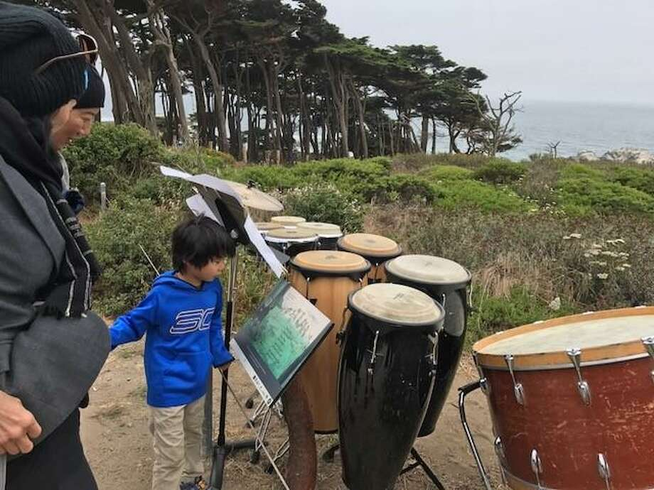 """Setting up percussion for """"Inuksuit"""" at Lands End."""