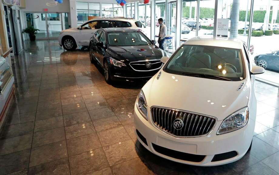 In this Wednesday, April 26, 2017, photo, 2017 Buick automobiles appear on display in the showroom at a GMC Buick dealership in Miami. U.S. sales of new cars and trucks were expected to show a decline in July 2017 as consumers pulled back on purchases and waited for Labor Day deals. July likely marked the seventh straight month of declines in a peaking market. (AP Photo/Alan Diaz) ORG XMIT: FLAD217 Photo: Alan Diaz / Copyright 2017 The Associated Press. All rights reserved.