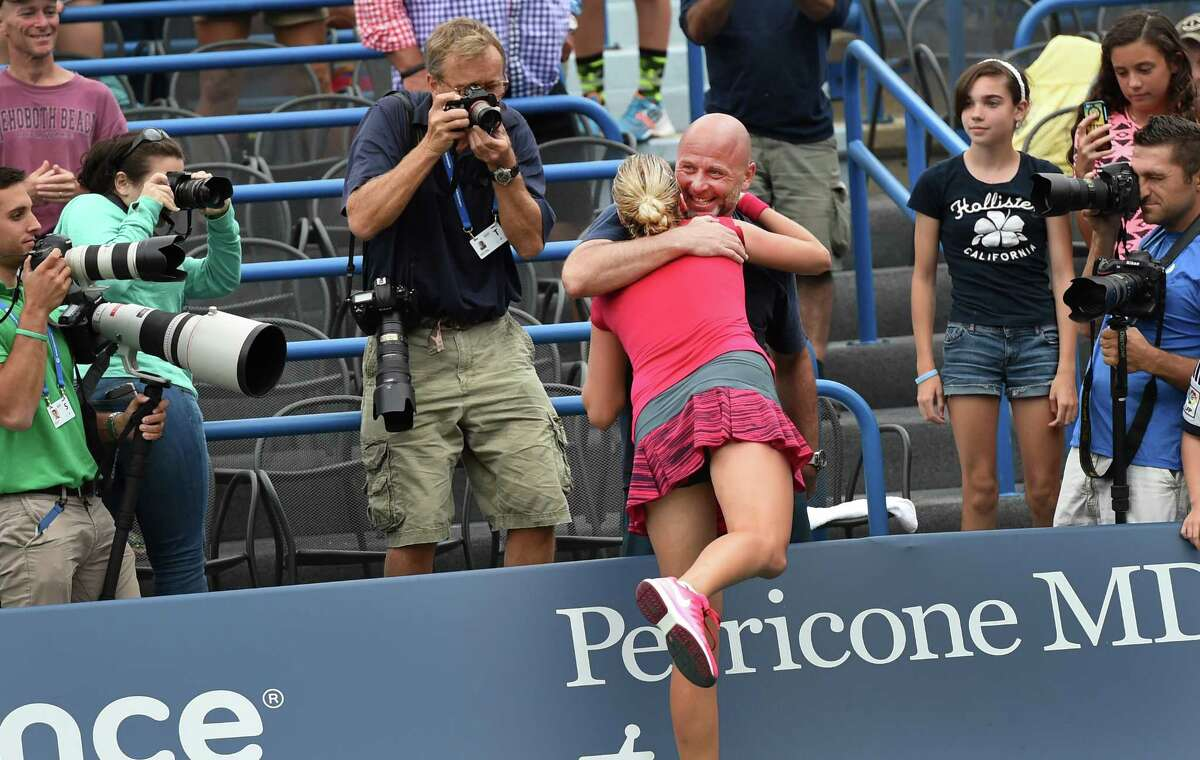 (Peter Hvizdak - New Haven Register) Petra Kvitova is hugged by her coach after defeating Magdalena Rybarikova at the Connecticut Open Women's single finals August 23, 2014 at the Connecticut Tennis Center in New Haven. Kvitova defeated Rybarikova 6-4, 6-2 to win her second championship in New Haven.