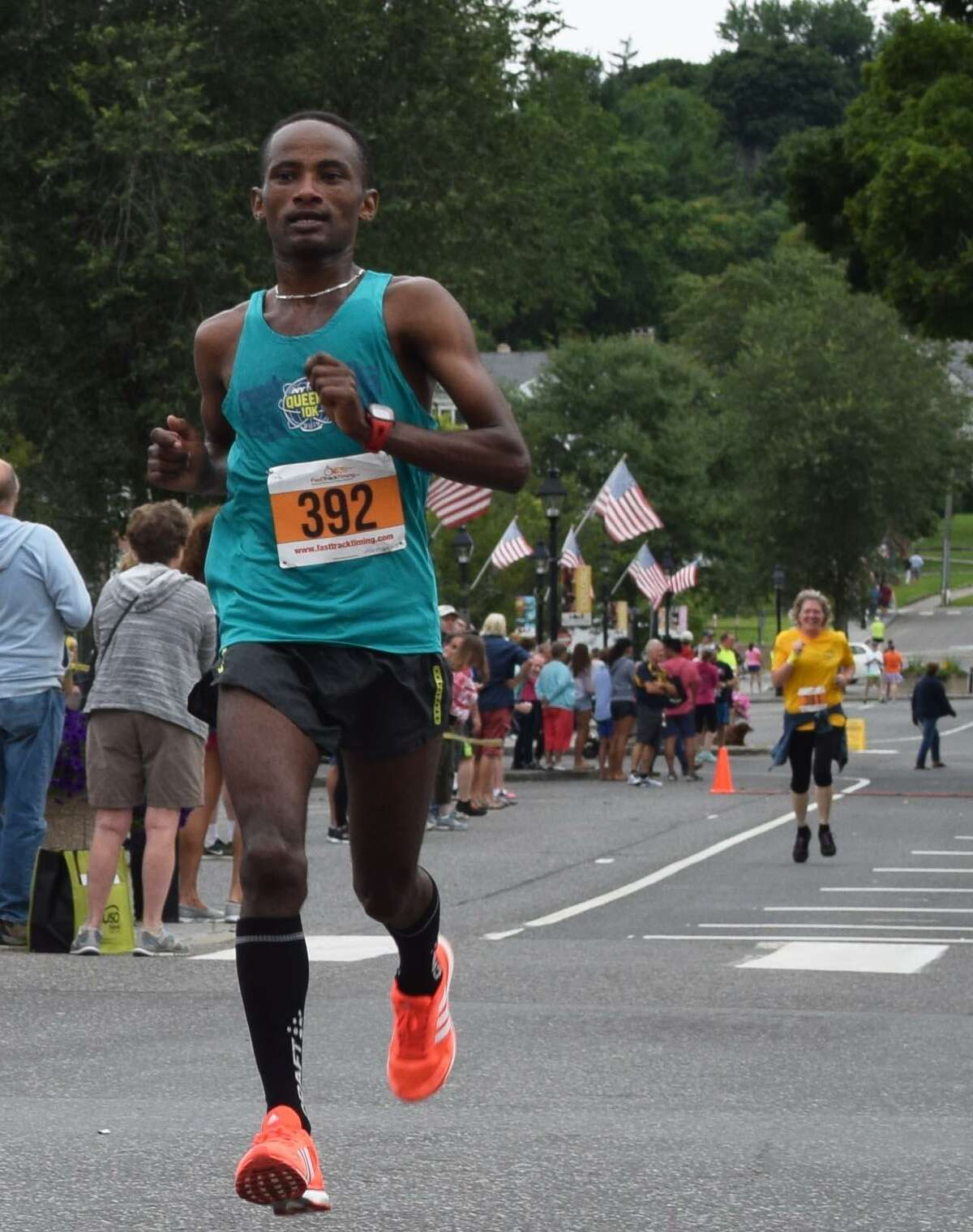 The 50th annual 8-Mile Road Race and 5K was held July 29 on conjunction with the Village Fair Days. More than 500 people participated. Abukebede Diriba of New York, N.Y., placed first in the eight-mile race with a time of 44:33. To view the top runners in various categories for each race and for more photographs, see next week's Spectrum and www.newmilfordspectrum.com.