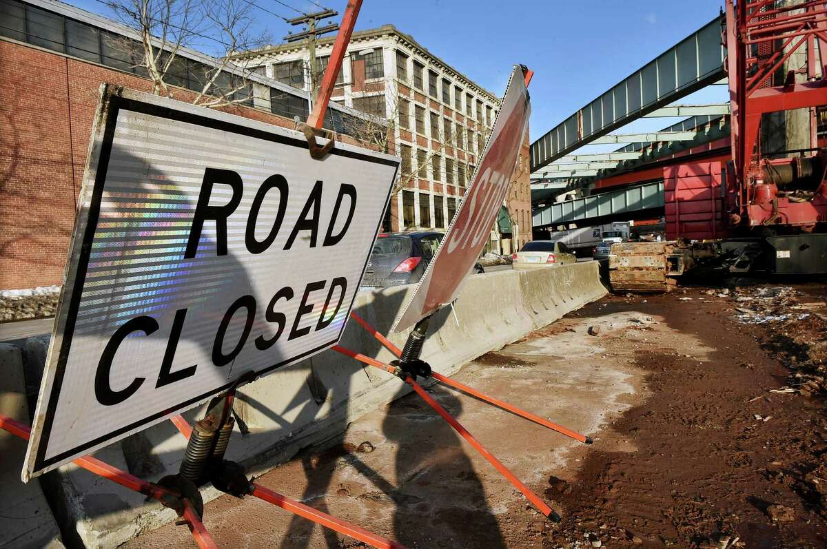 (Catherine Avalone - New Haven Register) The bridge which is just inches away from the C. Cowles & Company building at 83 Water Street in New Haven is seen Thursday, February 19, 2015. The Trumbull Street on-ramp to Interstate 91 southbound will be closed this weekend so that an unused bridge over Water Street can be removed, according to the state Department of Transportation. The ramp will close at 9 a.m. Friday and will reopen no later than 6 a.m. Monday, the DOT said in a press release. Drivers will be detoured to State Street and north to the Willow Street entrance of I-91 south. In addition, the right lane of I-91 south will be closed between Exit 4 and the off-ramp to Interstate 95 southbound from 9 p.m. Friday through 6 a.m. Monday.