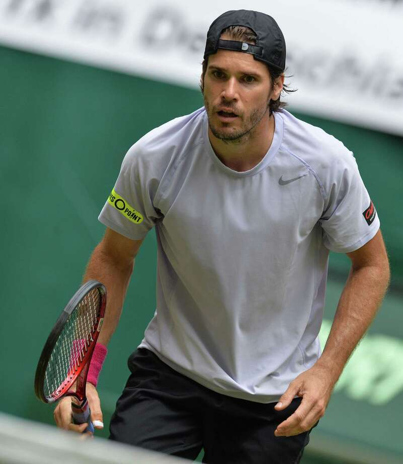German tennis player Tommy Haas reacts during the semifinal match against Swiss Roger Federer at the ATP Gerry Weber Open tennis tournament in Halle, Germany on June 15, 2013. Federer won 3-6, 6-3 and 6-4. AFP PHOTO / CARMEN JASPERSENCARMEN JASPERSEN/AFP/Getty Images Photo: CARMEN JASPERSEN / AFP