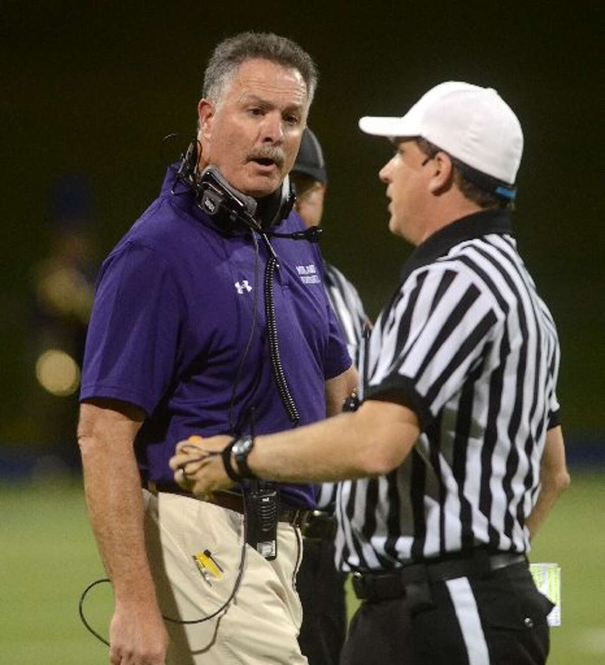Former Midland High head football coach Craig Yenzer talks to an official during a game against El Paso Franklin on Friday, Sept. 9, 2014 at Grande Communications Stadium. James Durbin/Reporter-Telegram
