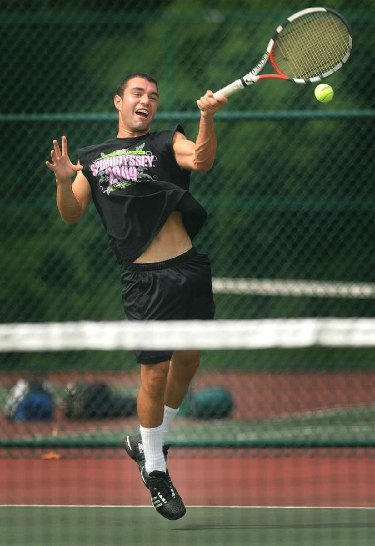 Trinity Catholic's Dante Terenzio slams a forehand at the boys state tennis open at Hamden High School on Monday, June 14, 2010. Terenzio, who will be attending the University of Louisville, is the defending state champion.