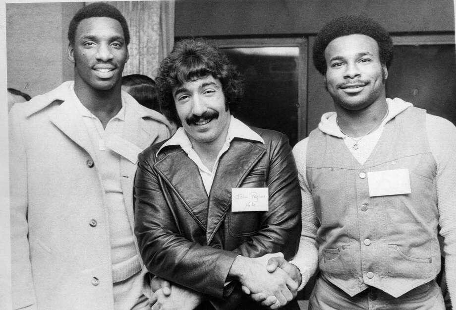 Yale running back John Pagliaro (center) of Derby with Grambling quarterback Doug Williams (at left) and LSU running back Charles Alexander at the 1977 Walter Camp All-America dinner.