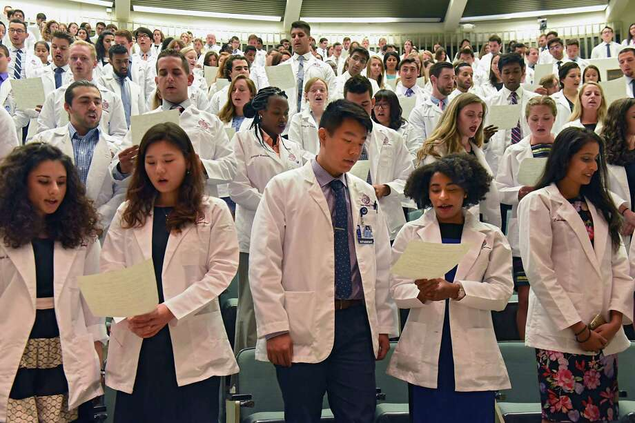 Albany Medical College students recite the Hippocratic Oath as AMC holds their White Coat Ceremony on Tues. Aug. 1, 2017 in Albany, N.Y. (Lori Van Buren / Times Union) Photo: Lori Van Buren / 20041166A