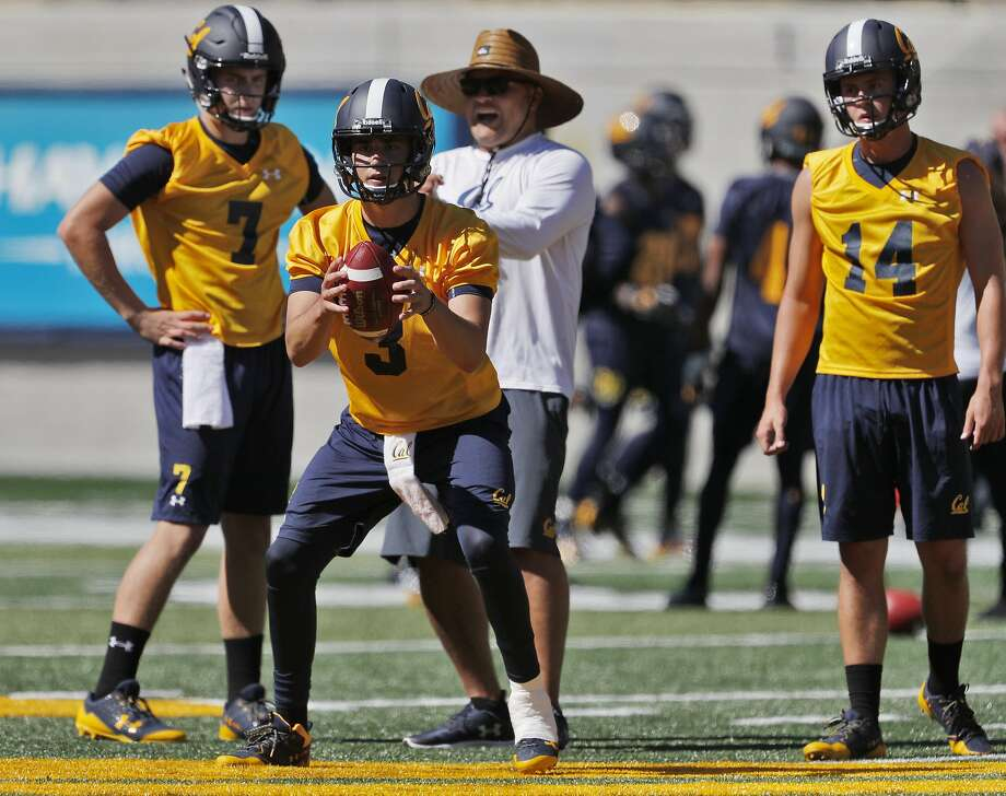 Cal Bears quarterback Ross Bowers (3) takes a snap while Chase Forrest (14) and Chase Garbers (7) look on  during Cal football practice at Memorial Stadium in Berkeley, Calif., on Monday, July 31, 2017. Photo: Carlos Avila Gonzalez / The Chronicle 2017
