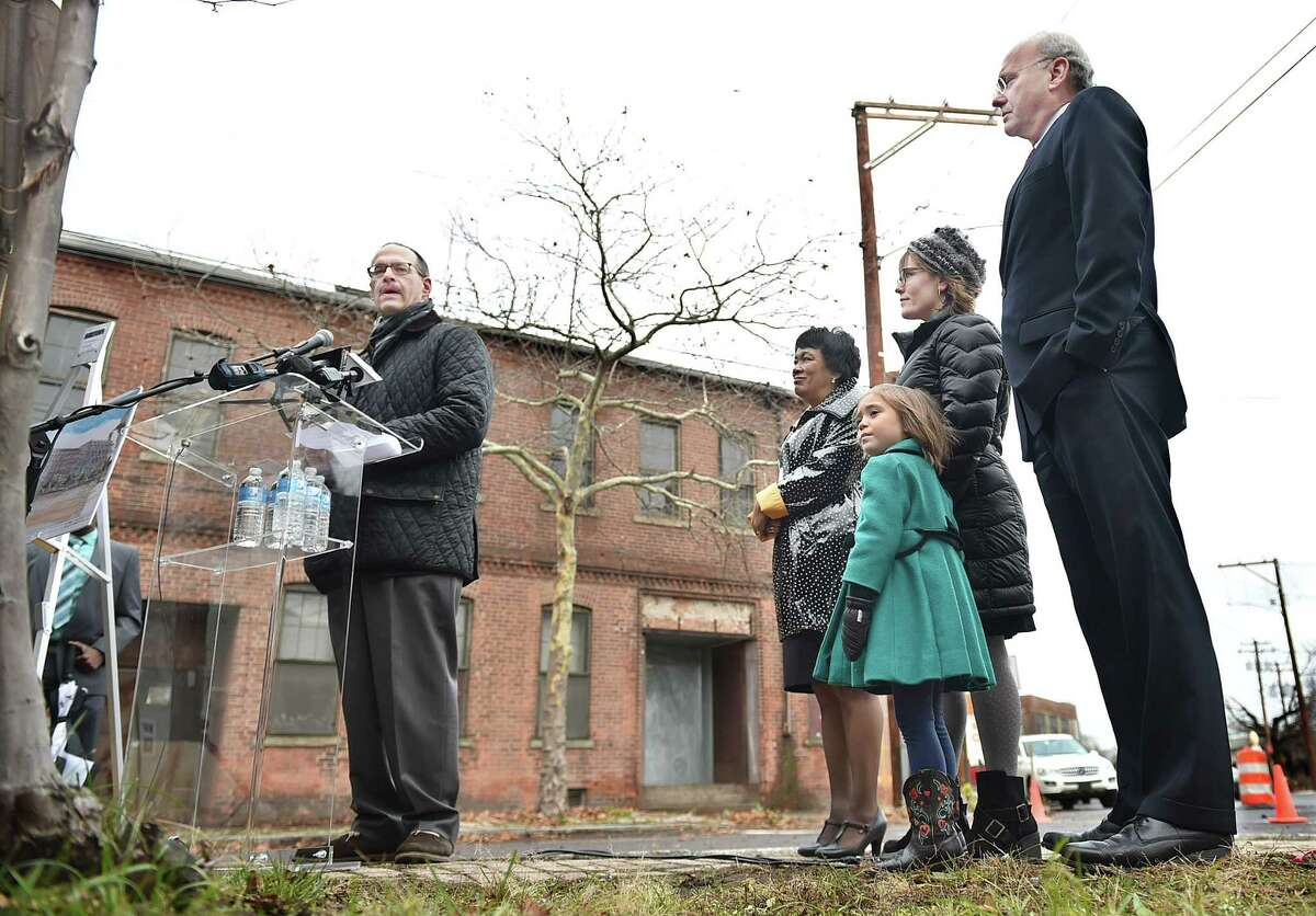(Catherine Avalone - New Haven Register) Developer Andrew Montelli, of Post Road Residentials Inc. speaks at the ground breaking of the State Street Lofts Project, a 3.1-acre industrial site in the Orange Street Historic District in the East Rock neighborhood in New Haven Wednesday, December 10. 2014. The existing brick building will include 4,000 square feet of retail space on the ground floor with three residential units above and 235 market-rate apartments. At right, Mayor Toni Harp, Alder Jessica Holmes and her daughter, and Economic Development Administrator Matthew Nemerson.