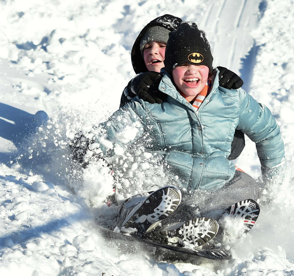 (Peter Hvizdak - New Haven Register) Jorge Velez, 11, left rear, and his sister Ana Laura Velez, 12, slide down a hill together at East Shore Park in New Haven Wednesday, January 28, 2015.