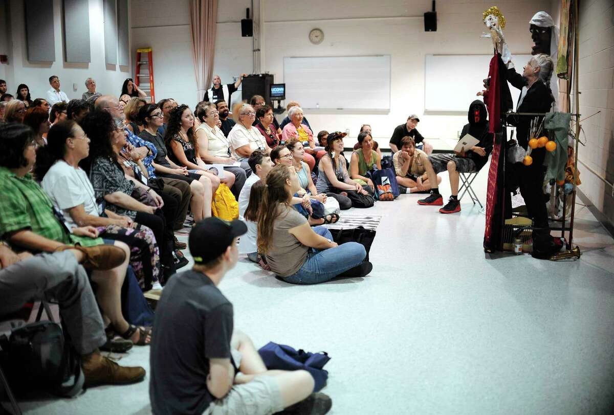 Amy Trompetter of Redwing Blackbird Theater performs for puppeteers attending at the National Puppetry Festival at the University of Connecticut, Monday, Aug. 10, 2015, in Storrs, Conn. Puppeteers from around the world began descending on UConn Monday to participate in the weeklong festival of all things puppet.