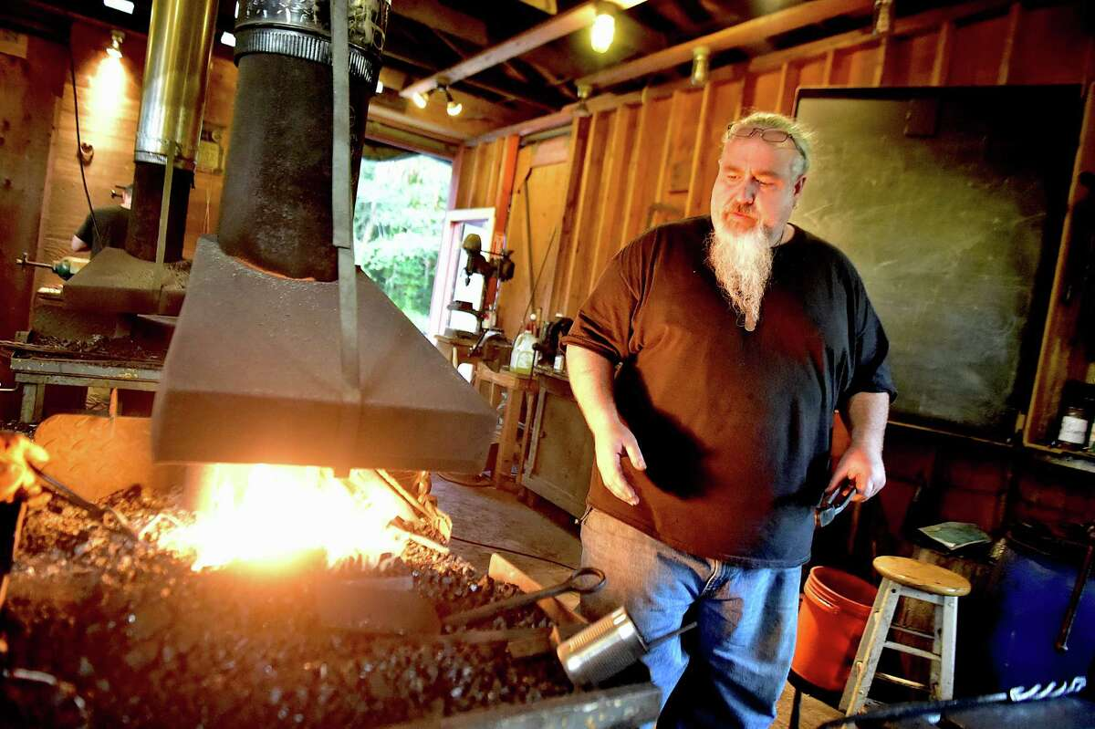 Guilford bladesmith Mace Vitale, owner of Laurel Rock Forge and rated journeyman smith with the American Bladesmith Society at the Guilford Art Center during a blacksmithing class he teaches, Wednesday evening, August 13, 2015. Vitale won the History Channel's Forged in Fire. (Catherine Avalone/New Haven Register)