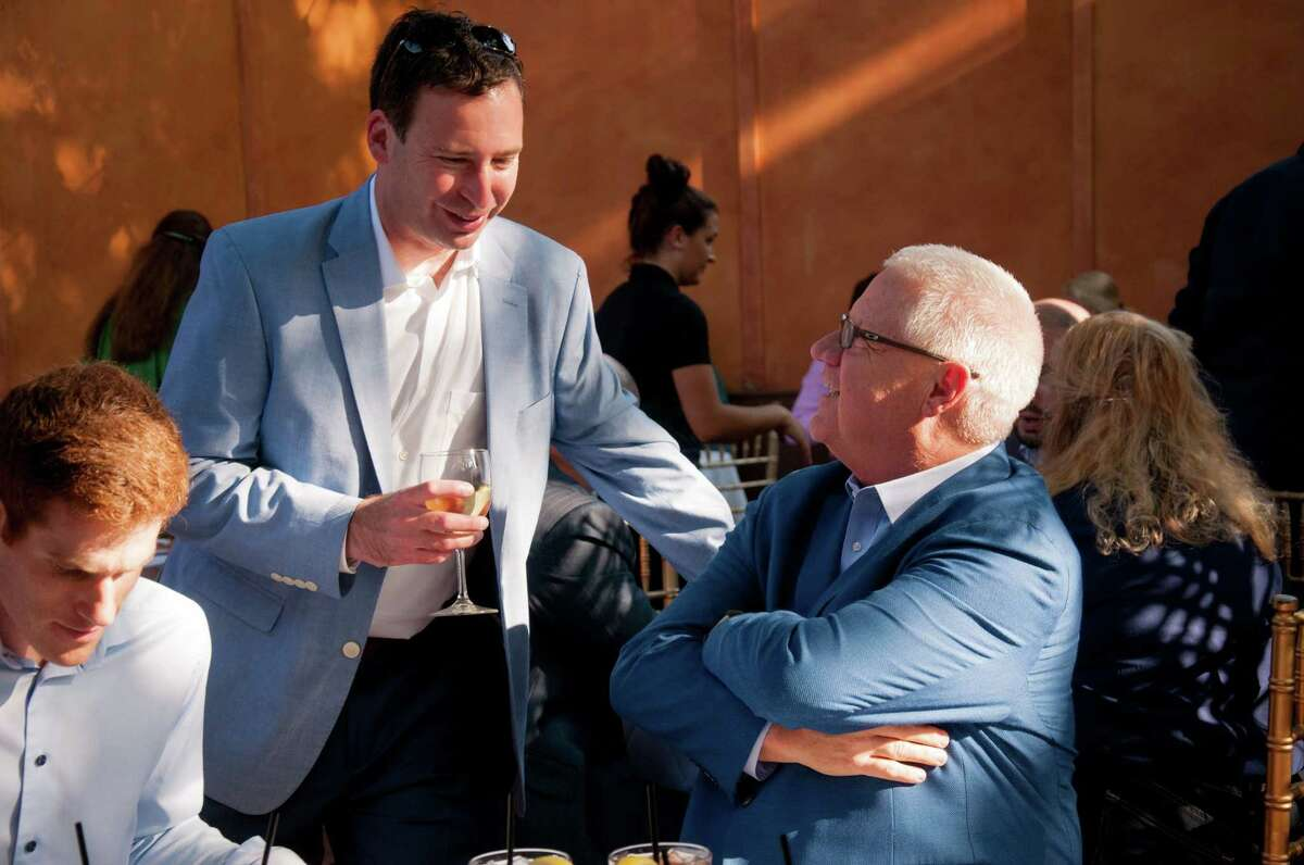 Jerry Crawford, owner of Keen Ice, right, talks with the owner of Ed Lewi Associates at Tuesday's post position draw for the Whitney Handicap at Sperry's Restaurant in Saratoga Springs, N.Y. (Jenn March/Special to the Times Union)
