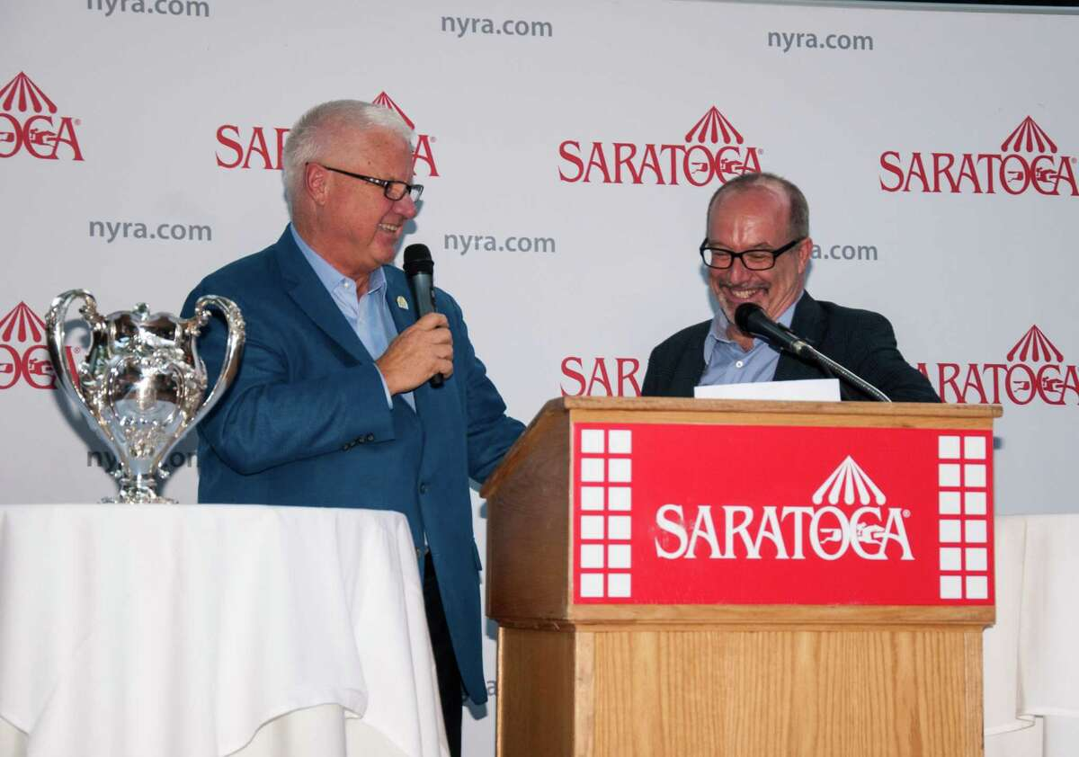 Speaker Andy Serling, right, interviews Jerry Crawford at Tuesday's post position draw for the Whitney Handicap at Sperry's Restaurant in Saratoga Springs, N.Y. (Jenn March/Special to the Times Union)