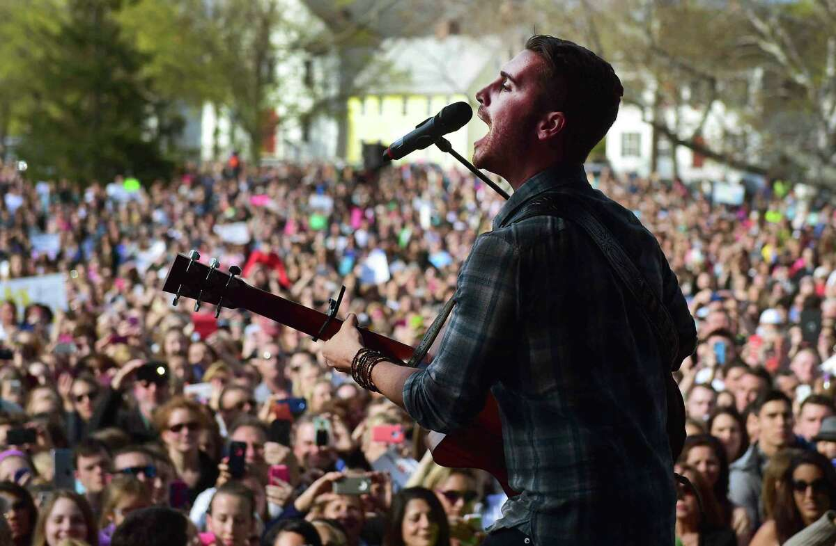 (Peter Hvizdak - New Haven Register) American Idol's Nick Fradiani of Guilford, performs a concert on the Guilford Green after a welcome home parade on Whitfield Street in Guilford, Connecticut Friday, May 1, 2015.