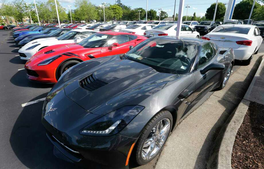 In this Wednesday, April 26, 2017, photo, Chevrolet Corvettes and other vehicles line the lot at a Chevrolet dealership in Richmond, Va. U.S. sales of new cars and trucks were expected to show a decline in July as consumers pulled back on purchases and waited for Labor Day deals. July likely marked the seventh straight month of declines in a peaking market. (AP Photo/Steve Helber) Photo: Steve Helber, STF / Copyright 2017 The Associated Press. All rights reserved.