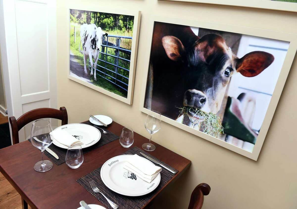 Cow prints decorate the walls of the Arethusa al tavolo restaurant in Bantam.