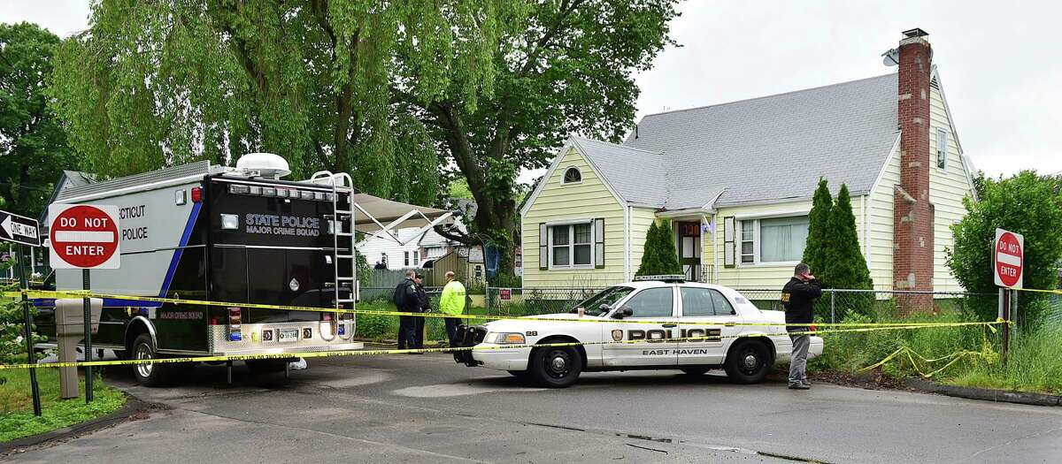 (Catherine Avalone-New Haven Register) Member of the Connecticut State Police Major Crime Squard and East Haven Police Department at the scene of an East Haven home at 541 Strong Street where two young children were found dead in their East Haven home at 541 Strong Street, Tuesday, June 2, 2015.