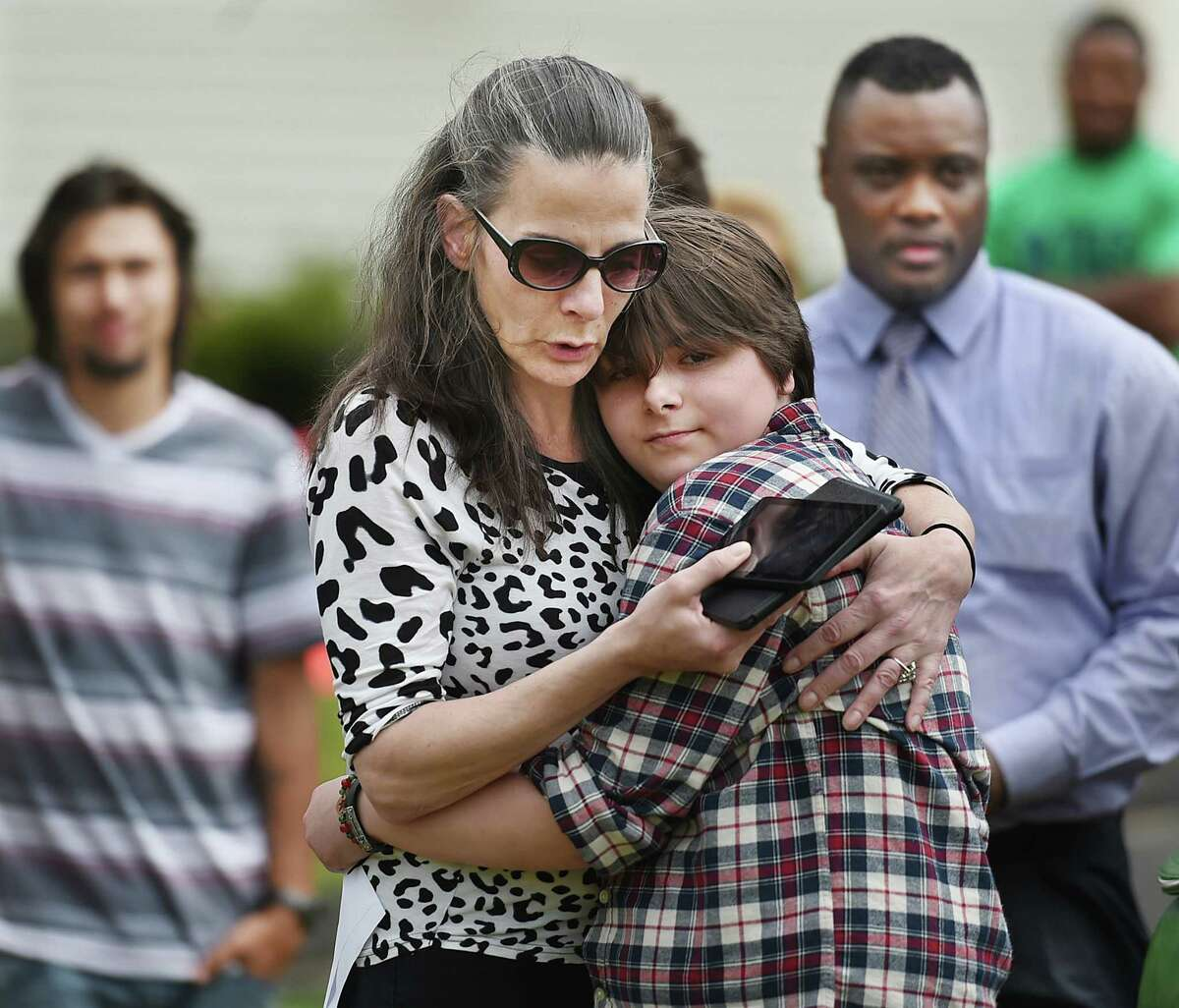 Theresa Torony, 18, and her mother, Alicia Buechner, of Bridgeport embrace following Torony's speech, Wednesday, May 18, 2016, at the main campus of Boys & Girls Village at 528 Wheelers Farms Road in Milford. The BGV held a ceremonial ground-breaking for a new facility after receiving a $2.16 million state grant. Torony admitted her childhood was filled with anxiety and depression but was happy to announce she is stable and plans to attend Sacred Heart University in the fall to earn a degree in social work. For 73 years, Boys & Girls Village, Inc. has provided behavioral health, permanency planning services and education for at-risk youth and their families from 50 communities within the state. (Catherine Avalone/New Haven Register)