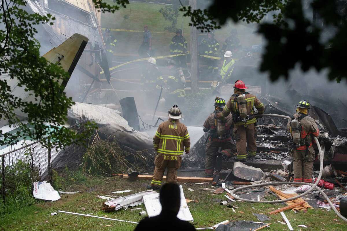 First responders respond to a plane crash into a house at 64 Charter Oak St in East Haven Friday August 9, 2013 .vmWilliams - Register