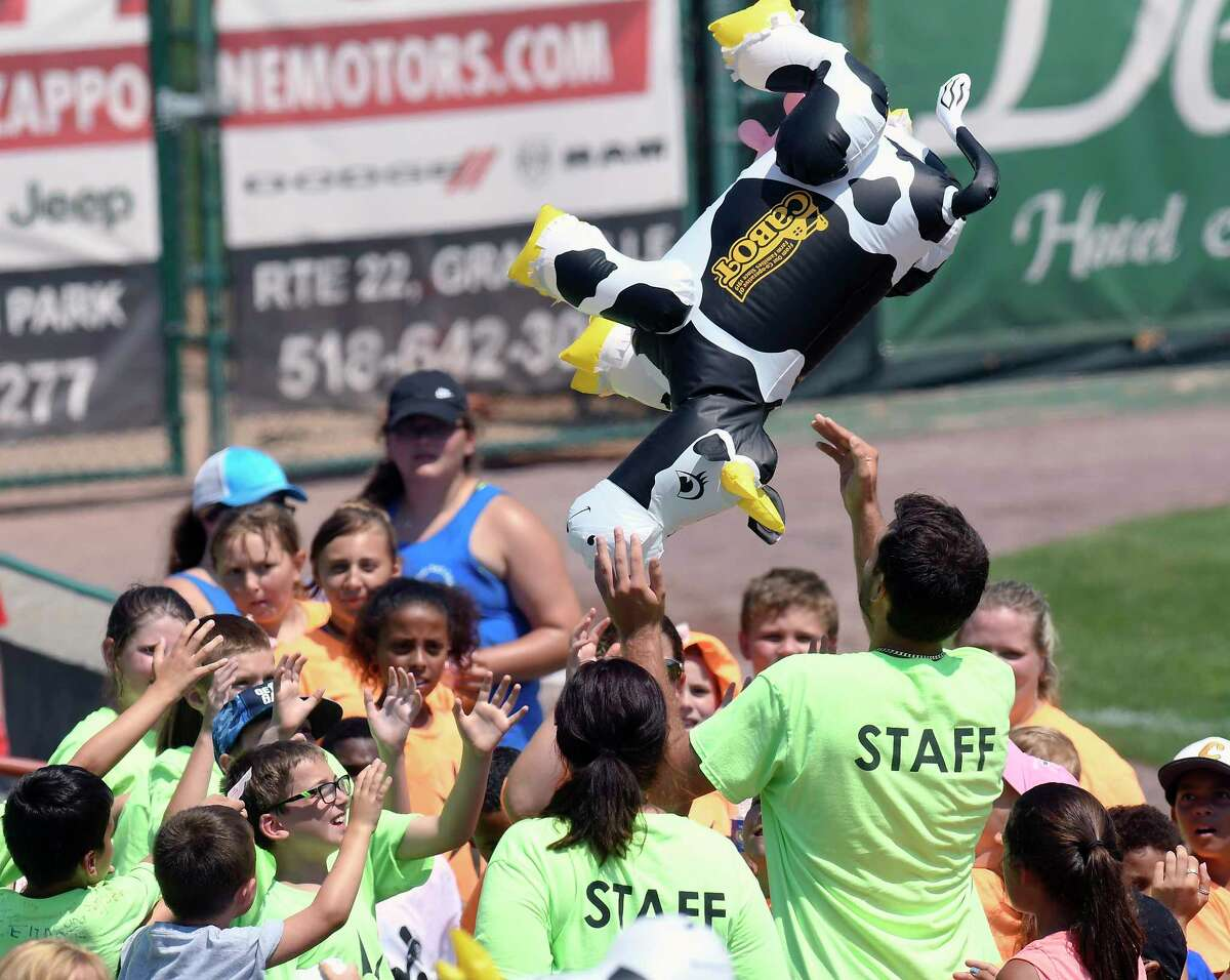 Fans bat around a plastic air filled cow during a promotional contest while taking part in Camp Day as the Tri-City ValleyCats play the Vermont Lake Monsters during a minor league baseball game on Tuesday, Aug. 1, 2017, in Troy, N.Y. (Hans Pennink / Special to the Times Union) ORG XMIT: HP102