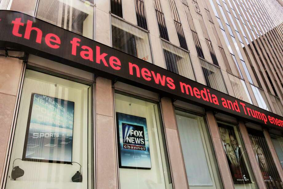 News headlines scroll above the Fox News studios in the News Corporation headquarters building in New York, Tuesday, Aug. 1, 2017.  Fox contributor Rod Wheeler, who worked on the Seth Rich case, claims Fox News fabricated quotes implicating the murdered Democratic National Committee staffer in the Wikileaks scandal and that President Donald Trump pressured Fox to publish the story. He sued Fox for defamation on Tuesday. (AP Photo/Richard Drew) ORG XMIT: NYET223 Photo: Richard Drew / AP