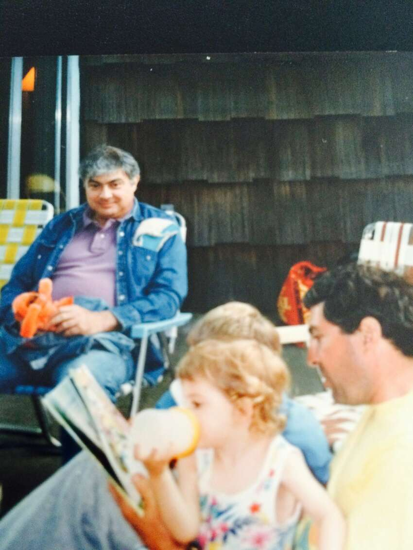 Michael Villano, seated in jean jacket, at an undated family gathering on Long Island with his brother, Steve Villano, in yellow shirt. (Photo courtesy of Steve Villano) ORG XMIT: 1rXBYcWNkzMLohkUe9G-