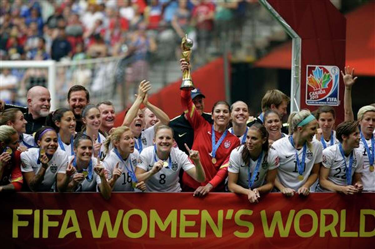 The United States Women's National Team celebrates with the trophy after they beat Japan 5-2 in the FIFA Women's World Cup soccer championship in Vancouver, British Columbia, Canada, Sunday, July 5, 2015.