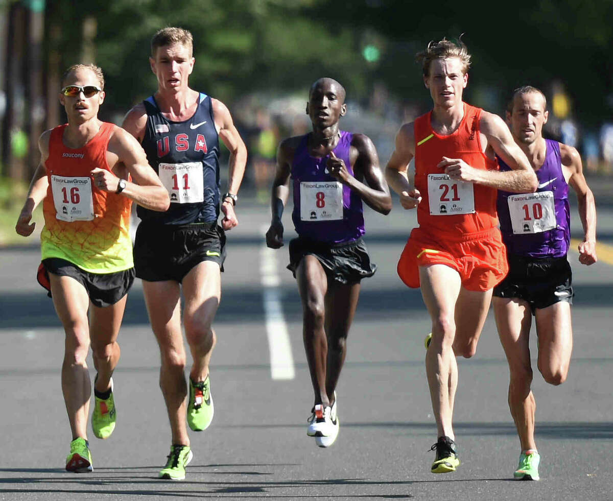 (Peter Hvizdak - New Haven Register) First place finisher Jared Ward of the U.S.A., left, runs down the home stretch of Whitney Ave in a close race against (second from left to right) fourth place finisher Luke Puskedra, second place finisher Sam Chelanga, fifth place finisher Tyler Pennel, and third place finisher Dathan Ritzenhein, en route to winning the 2015 New Haven Road Race Men's 20K and the 20K Men's National Championship in New Haven, Connecticut Monday, September 7, 2015 with a time of 59:24. 11 seconds separated the first five finishers.