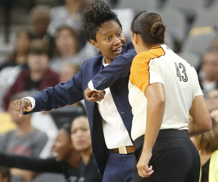 Stars head coach Vickie Johnson tries to get a call from official Brenda Pantoja in WNBA game between the Stars and New York Liberty at the AT&T Center on Tuesday, Aug. 1, 2017