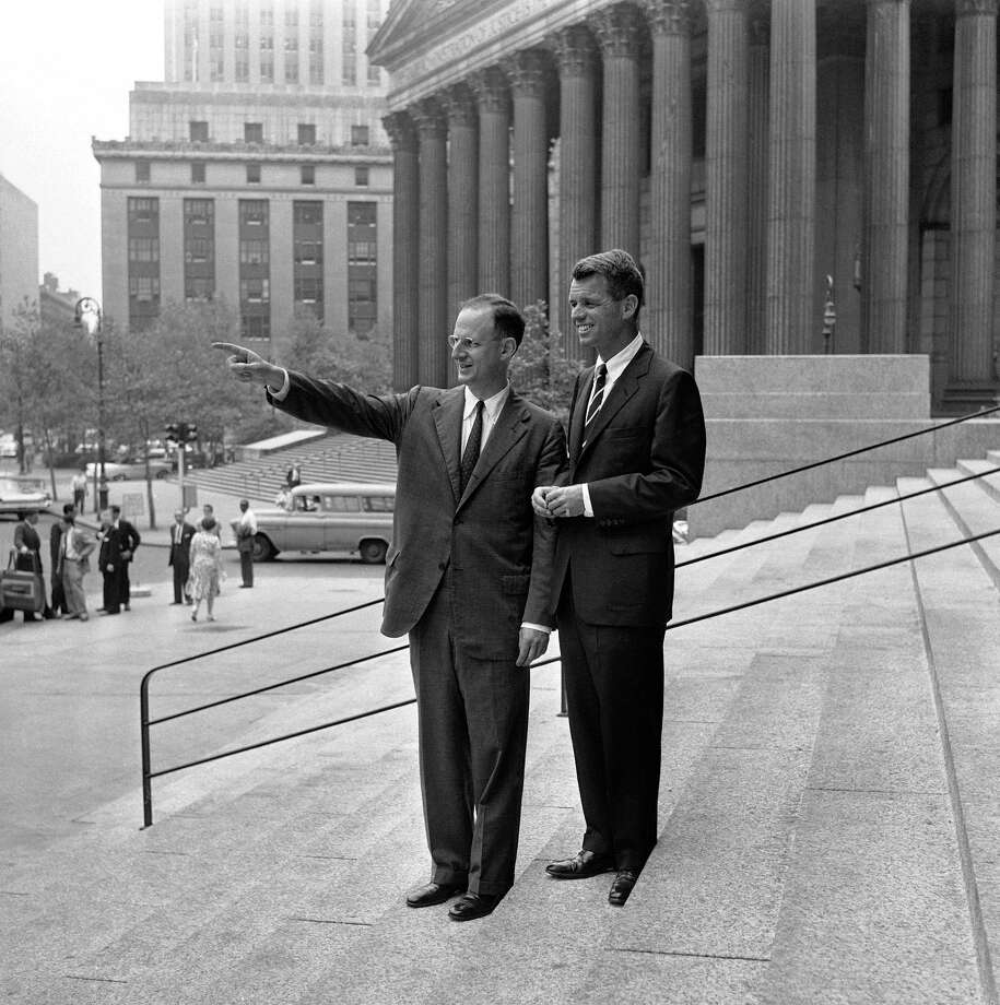 Robert M. Morgenthau, left, U.S. Attorney for the southern district of New York and Attorney General Robert Kennedy, pose on the steps of the U.S. Courthouse in New York City on June 14, 1961 following Kennedy's visit there. Photo: Anonymous, AP / AP1961