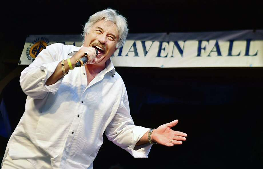 "Tony Orlando performs ""Tie a Yellow Ribbon Round the Ole Oak Tree"" in front of hundreds at the East Haven Fall Festival at the East Haven Town Green, Saturday, September 12, 2015. Originally performed by Tony Orlando and Dawn, in 1973, ""Tie a Yellow Ribbon Round the Ole Oak Tree"" reached number one in April 1973 and in 2008, Billboard ranked the song as the 37th biggest song of all time. (Catherine Avalone/New Haven Register) Photo: Catherine Avalone / Catherine Avalone/New Haven Register"