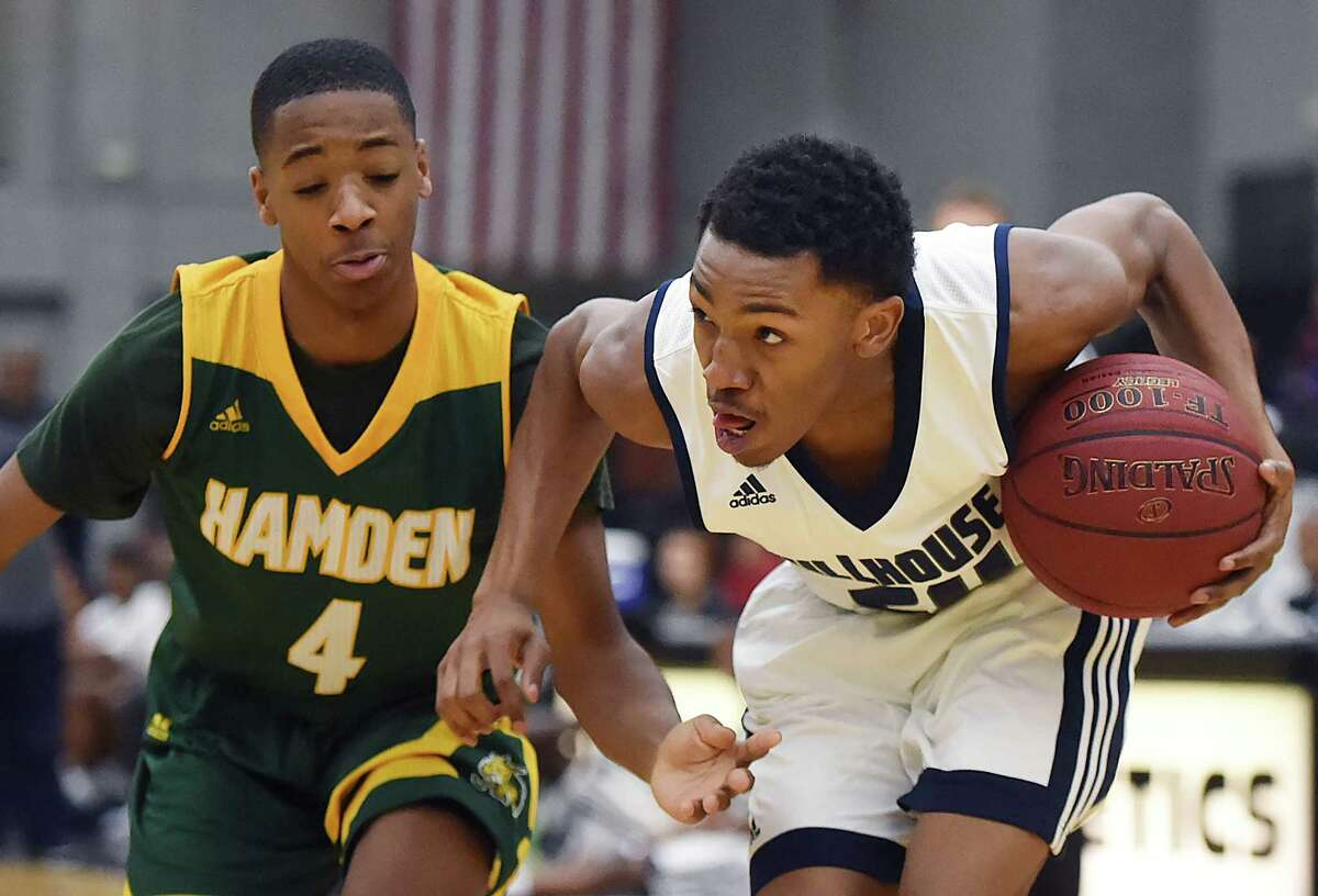 Hillhouse's J'Vaughm Hoover drives to the paint as Hamden senior guard Douglas Daniels defends as the Academics defeat the Green Dragons, 62 - 58, Thursday, January 19, 2017, at the Floyd Little Athletic Center in New Haven. (Catherine Avalone/New Haven Register)