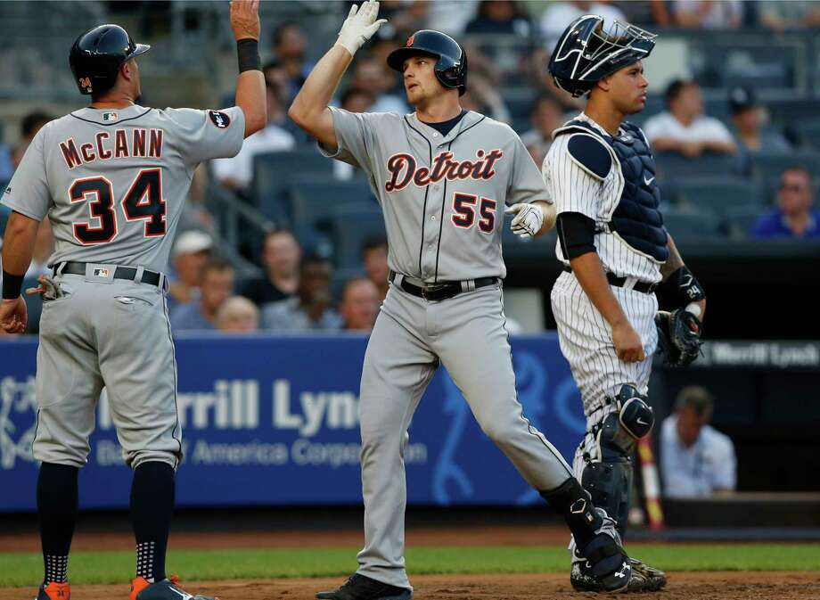Detroit Tigers' James McCann (34) greets John Hicks at the plate after Hicks' three-run home against the New York Yankees during the second inning of a baseball game at Yankee Stadium in New York, Tuesday, Aug. 1, 2017. Yankees catcher Gary Sanchez is at right. (AP Photo/Kathy Willens) ORG XMIT: NYY106 Photo: Kathy Willens / Copyright 2017 The Associated Press. All rights reserved.