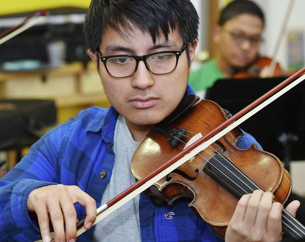 Violinist Cris Zunun, 16, practices with Harmony in Action, Music Haven's youth chamber orchestra., Friday, March 17, 2017.