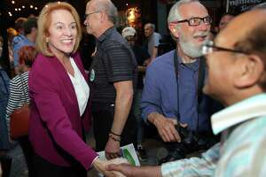 Seattle Mayoral candidate Jenny Durkan and her supporters celebrate her first place position in the primary race, as returns come in Tuesday, Aug. 1, 2017.