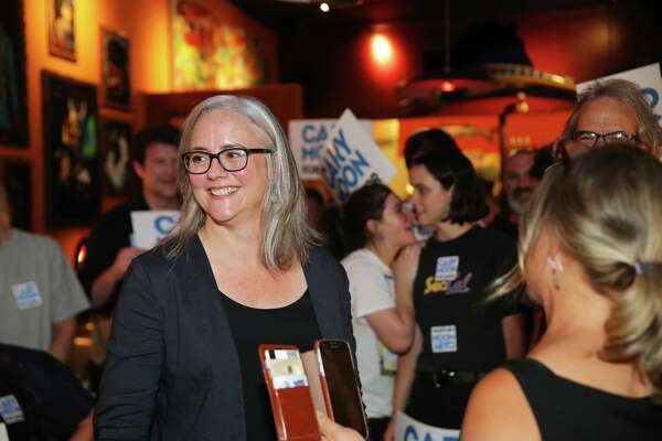 Seattle Mayoral candidate Cary Moon and her supporters celebrate her second place position in the primary race, as returns come in Tuesday, Aug. 1, 2017.