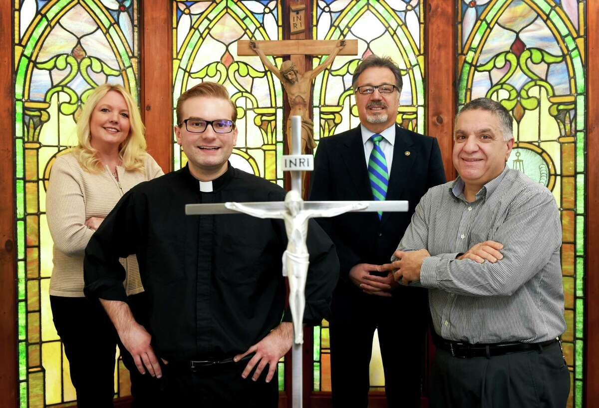 (Peter Hvizdak - New Haven Register) Cyndie Baker, St. Ambrose Parish Operations Manager , Father Robert L. Turner, Pastor of St. Ambrose Parish, Deacon Ernie Scrivani, Director of the Archidiocese of Hartford's Office of Pastoral Planning, and Deacon Joe Marenna, St.Ambrose Parish Business Manager, left to right, Monday, March 21, 2016 in the St. Augustine Roman Catholic Church Celebration Hall chapel in North Branford that is used for daily mass.