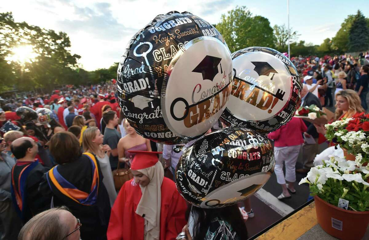 Images of Branford High School's class of 2017 commencement exercises, Friday, June 9, 2017, at the Branford Town Green. (Catherine Avalone / Hearst Connecticut Media)