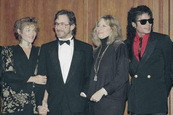 Film director Steven Spielberg is flanked by his wife Amy Irving, right, and singer Barbra Streisand, and joined by entertainer Michael Jackson after he received the Scopus Awards of the American Friends of the Hebrew University, Dec. 14, 1986, in Los Angeles. Spielberg was honored as one of Hollywood's most successful filmmakers and for his humanitarian efforts. (AP Photo/Mark Avery)