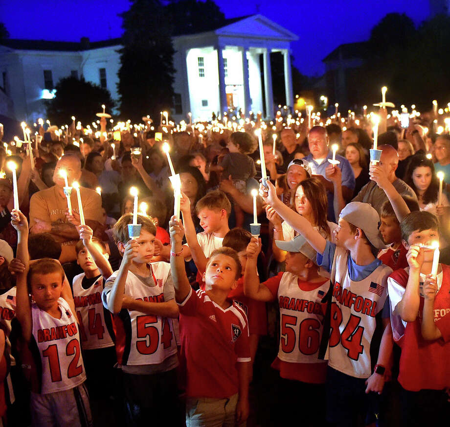 (Peter Hvizdak - Hearst Connecticut Media) Branford, Connecticut: July 9, 2017. Thousands of people attended a candlelight vigil on the Branford Green Sunday evening celebrating the life of drowning victim Ben Callahan, 10, of Branford. Photo: Peter Hvizdak / Peter Hvizdak