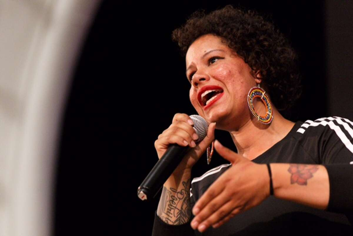 Nikkita Oliver, running third after the first release of returns, addresses supporters at Washington Hall in Seattle, Aug. 1, 2017.